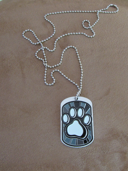 Paw print dog tag is the unique finisher medal.